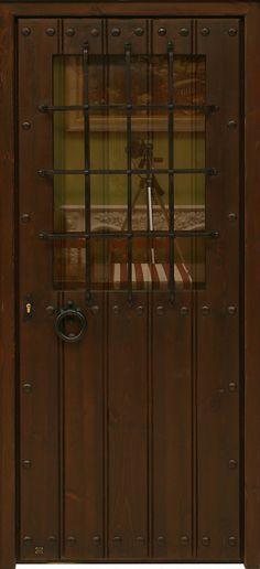 Puerta rústica de una hoja con reja de canasta, cristal y tapaluz de duelas.Estructura y marco de pino macizo. Duelas a una cara de madera antigua de pino recuperada. Cristal normal incluido. Clavos y demás herrajes de hierro forjado artesanalmente.Cerradura de seguridad y manivela rústica incluida. Acabado anticuario con pátina de cera.