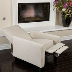 Feel rejuvenated when you perch in this petite recliner club chair. It includes a handy built-in footrest for complete relaxation.