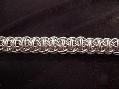 Fire Wyrm - плетение на основе полного персидского. — Плетение из колец и проволоки