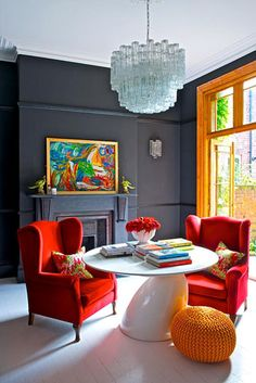 Colourful living room – © Ingrid Rasmussen/GAP Interiors (loveeee the red arm chairs)