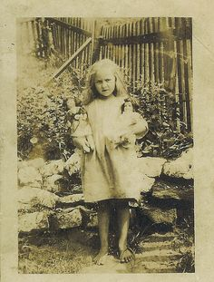 VINTAGE PHOTO: Little Girl With 2 Dolls, Standing Barefoot in Garden. Circa early 1900 --- (by ordinday, via Flickr)