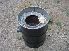 Homemade tandoori oven.  Non galvanized steel drum vermiculite, fire bricks, large clay pot bottom cut off  for pipe, exhaust pipe.
