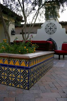 interesting idea... a tiled flower bed