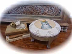 Foot stool becomes a cat bed via PennyWise: Thrift Benefit for Sheltered Animals: Animal Lifeline