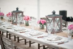 Greyed wood lanterns and pink roses - rustic chic perfection!