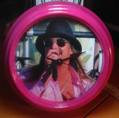 """Pink Wall Clock - Kid Rock Pink Shirt $20.  I can use your photo if you prefer.  Contact me and I will tell you how.  This is a plastic wall clock approximately 9"""" round."""