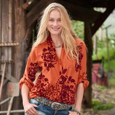 This elegant blouse blooms with the subtle texture of flocked velvet vines and blossoms.