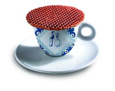 Cup of coffee with a Daelmans Stroopwafel on top