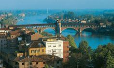 Ticino covered bridge, Pavia, Italy. Photograph by Alamy