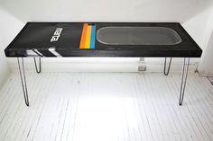 Retro railroad repurposed: 80s subway door converted to table. Gamer den.