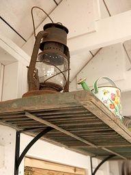 Use old shutters for shelves in potting shed. Shutter shelf via BHG Home Goods Decor, Diy Home Decor, Old Window Shutters, Repurposed Shutters, Vintage Shutters, Old Shutters Decor, Metal Shutters, Bedroom Shutters, White Shutters