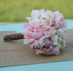 peonies and ranunculas in soft pink and ivory.