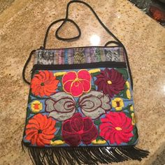 Original Oaxacan  hand embroidered crossbody Beautiful Oaxacan Mexican hand embroidered colorful crossbody... Beautiful flower design...zipper on the top...handmade small flaws.... Approx. 8 inches by 6 inches Bags Mini Bags