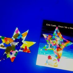 Tissue paper and glue on white cardboard to recreate our own stars with Eric Carle book theme.