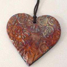 Raku heart ornament by CharlotteLeePottery on Etsy