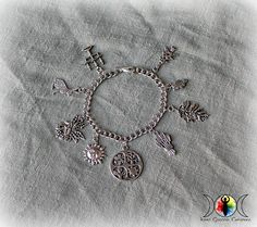 Made from stainless steel and pewter, this Witch's Sabbats Charm Bracelet beautifully displays the 8 major holidays of most earth-centered belief paths. This bracelet includes (from left to right in t