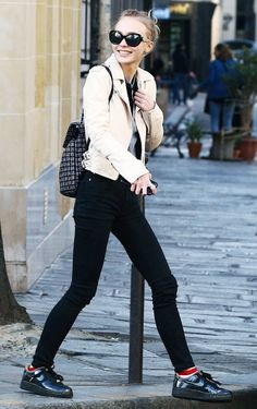 Sneakers and black skinny jeans get an instant oomph, thanks to a cool leather jacket.