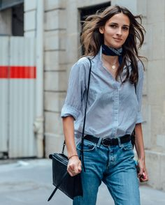Translucent striped, button-down; black bra; belted boyfriend jeans; and a black cross-body. Add some cute sandals, your phone, and some sunglasses, and you're set for the day.
