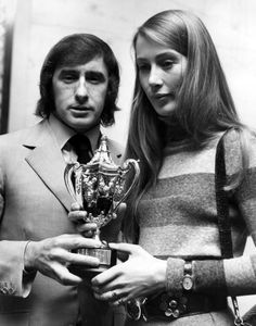 Jackie Stewart hands the championship trophy to Nina Rindt in the absence of her husband who died chasing this trinket. Surely the saddest photograph in motorsport.