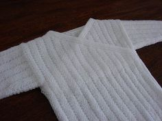 Baby Vest by Sirdar Spinning Ltd.