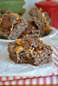 Turtle Rice Krispies Treats - 3 tbsp of butter, 1 - 10 oz. package of marshmallows, 6-7 cups chocolate Krispies cereal (like Kellogs Cocoa Krispies), approx. 12 tbsp melted caramels, approx. 12 tbsp melted chocolate, appox. 12 tbsp chopped pecans.