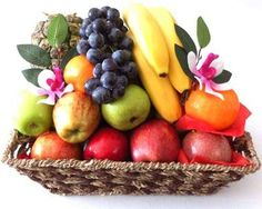 Fruit Basket Gift with Metal Handles - made of natural seagrass and filled with seasonal fruits.