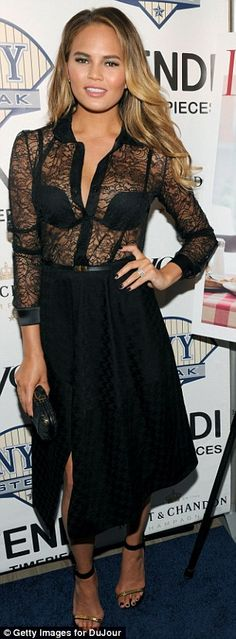 Chrissy Teigen showed her appetite for style in a black lace blouse at a DuJour magazine and NYY Steak party http://dailym.ai/1uEgH5O