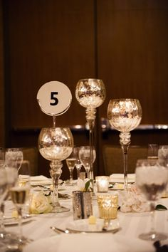 Glowing #Mercury Glass Candleholders | Photography: Brinton Studios | See the wedding here: http://stylemepretty.com/2013/08/07/classic-denver-wedding-from-brinton-studios/