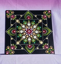 Hand painted Dot Mandala Painting has the unique appearance of having 3 Stacked paintings on top of each other. Embellished with Swarovski Crystals, especially beautiful in low light. Inspired by David Ander, this would be a treasured gift enjoyed by all! Free shipping on orders