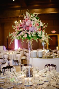 Tall glass cylinder centerpiece with pink hydrangea, dark pink peonies, pink cymbidium orchids, and white snapdragons | Lasting Images Photography | villasiena.cc