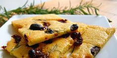 Coconut Butter Focaccia   [1 c coconut butter, warmed,  5 large eggs, room temp 3 tbl olive oil or ghee,  1/2 tsp salt,  1 clove garlic,  1 sprig fresh rosemary,  1/4 cup each sun-dried tomatoes/olives, or your favorite toppings, 375 25m]