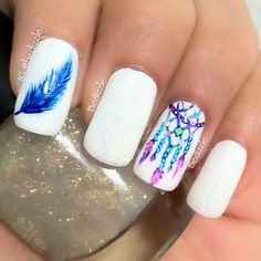 Immaculate in white and blue watercolor nail art design. Use white as your base color and paint it as matte on your nails. Add details in various blue polishes and a touch of lavender for effect.