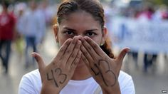 A student takes part in a protest by students of the Ayotzinapa school and parents of the 43 missing students in Acapulco on 19 November 2014.