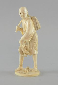 Japanese carved ivory figure of a fisherman holding two fish and carrying a wicker basket on his shoulder, 18.5cm high,