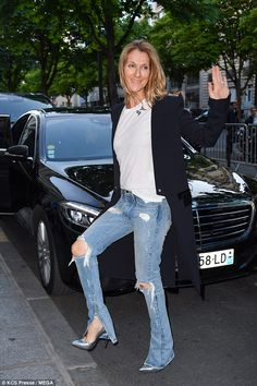 Leggy: Cutting a stylish figure, Celine teamed ripped jeans with a pair of grey killer hee...