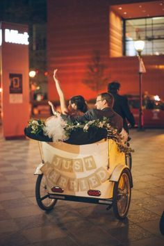 Wedding reception get away in a PediCab. Just Married. Photography: Lauren Rosenau   Wedding Planning and Design: The Graceful Host   Flowers: New Creations Flower Company   Venue: Mint Museum Uptown   Charlotte, North Carolina Wedding