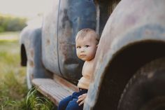 1 year old baby boy on old vintage truck by At Play Photo in Cedar Falls, IA