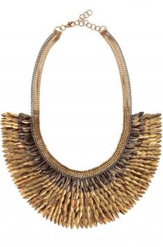 """A striking bib of intricate gold feathers hand sewn to silk organza cascade. Made entirely by hand in India.          As seen on Kourtney Kardashian and in Lucky & InStyle Magazine!        4"""" of chain on each side with a 2"""" extender.        16 1/2"""" length.        Lobster clasp.        Lead & nickel safe."""