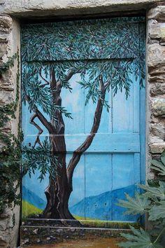 Arte urbano en puertas | Olivenbaum Tür