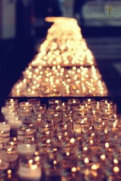 Hundreds of tea light candles via Ambient Lighting / Wedding Style Inspiration