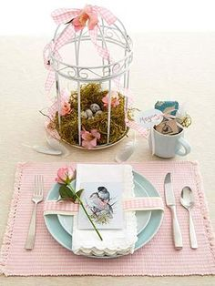 Spring arrangement in bird cage  Display my chicken dinnerware set..Yellow and green  birdcages/nests,etc