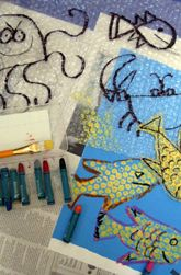 Make an Impression-the basics of printmaking. This is a great follow up project for a trip to an aquarium. Sheets of bubble wrap, A dark blue piece of construction paper, Scissors,  Paint trays, Colorful tempera paint, Newspaper, Oil pastels, Black marker