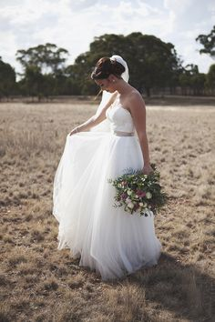 Bridal gown with tulle skirt and lace sweetheart bodice for country wedding | Leah Ladson Photography | See more: http://theweddingplaybook.com/classic-country-romance-wedding/