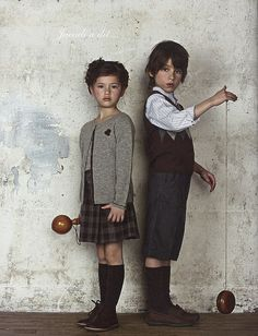 the girl on the left looks like an Animal, and the child on the right looks more Earth