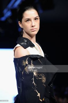 A model walks the runway wearing Celestine Studio at Vancouver Fashion Week Fall/Winter 2017 at Chinese Cultural Centre of Greater Vancouver on March 2017 in Vancouver, Canada. Winter 2017, Fall Winter, Cultural Center, Walks, Vancouver, Centre, Runway, March, Chinese