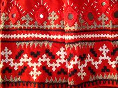 kutchwork on red blouse-closeup border