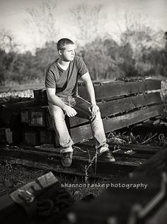 Shannon [Photography]. Senior Portrait. Boy pose at railroad track.