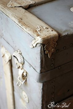 What to do with an old trunk not in the best of shape anymore :: From Girl in Pink :: Old Trunk painted the entire piece with two coats of Chalk Paint Decorative Paint® by Annie Sloan in Paris Grey and accented the wood slats with Old Ochre and metal hardware in Old White.
