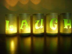 """Laugh"" tea lights made from cut beer bottles"