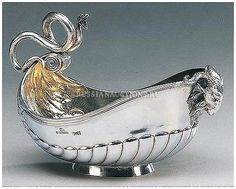 A silver kovsh by Fabergé with the Imperial warrant, Moscow, 1893. The bowl chased with lobing and acanthus leaves, the handle applied with a writhing serpent, the prow with a ram's head, gilt interior.